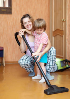 Mom and son with vacuum cleaner